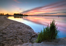 Beach at morning in HDR. Sunset at lake, high dynamic range Stock Images