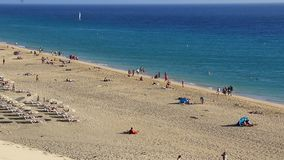 Beach in Morro Jable, Fuerteventura, Canary islands, Spain. Panoramic view of sandy beach in Morro Jable town, Fuerteventura island, Canary islands, Spain stock footage