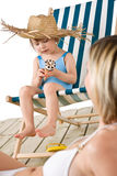 Beach - Mother with child with ice-cream cone Stock Photo