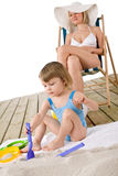 Beach - Mother with child play with toys in sand Royalty Free Stock Image
