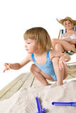 Beach - Mother with child play with toys in sand Stock Photos