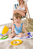 Beach - Mother with child play with toys in sand Royalty Free Stock Images