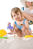 Beach - Mother with child playing with toys. In sand Stock Images