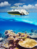 Beach and motor boat with coral reef underwater view. Beautiful beach and motor boat with coral reef bottom underwater and above water split view Stock Photos