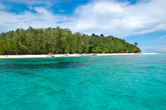 Beach with motor boats on turquoise water Royalty Free Stock Photo