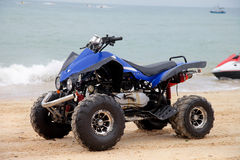 Beach motorcycle. Blue beach motorcycle by the sea Stock Photos