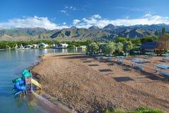 Beach on a mountain lake . Lake Issyk-Kul, Kyrgyzstan Royalty Free Stock Photo