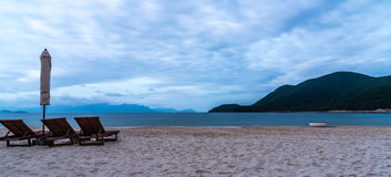 Beach mountain sea and Lounge chair Royalty Free Stock Photo