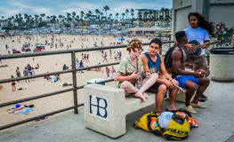 Beach Music Jam. Young friends break out into a spontaneous music jam on Huntington Beach with a ukulele and guitar Stock Photography