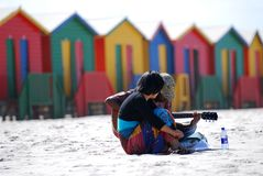 Beach Musicians. Young musicians on colourful Muizenberg Beachfront, cape Town Stock Photo