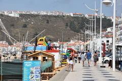Beach at Nazare fishing village in Portugal Stock Photos