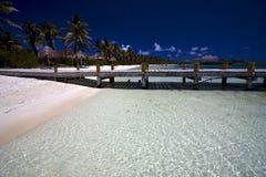 Beach near the harbor Royalty Free Stock Image