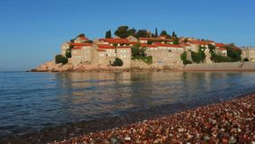 Beach near the island of Sveti Stefan, Montenegro stock video footage