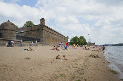 The beach near the Peter and Paul Fortress cloudy day. St. Petersburg Stock Image
