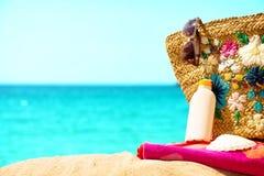 Beach necessities at the sunny beach Stock Photo