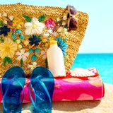 Beach necessities at the sunny beach Royalty Free Stock Photo