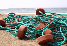 Beach Nets. Fishing net with floats on the beach Royalty Free Stock Image