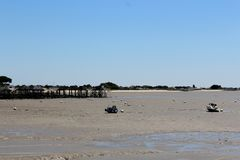 Beach and nets at low tide. Photo taken during an excursion in the region of the Arcachon Basin Royalty Free Stock Photos