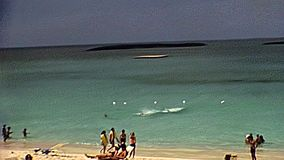 Bahamas New Providence beach. Beach of New Providence island with tourists sunbathing in resort in 70`s. The historical Bahamas in 1978 stock footage