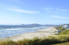 The beach and coast in Newport, Oregon. Sandy beach and ocean in Newport, Oregon Stock Photo
