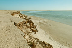 Cliff Beach. Beach next to a rocky cliff in Dakhla, Western Sahara Stock Image