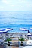 Beautiful beach and many blue parasols Royalty Free Stock Photo