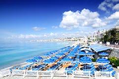 Beautiful beach and many blue parasols Stock Photography