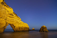 Beach at night with blue sky Stock Images