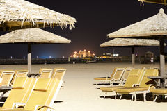 Beach night illumination with a view on Palm Jumeirah Royalty Free Stock Photos