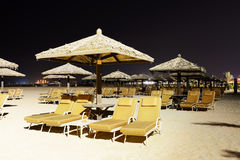 Beach night illumination with a view on Palm Jumeirah Stock Photos