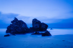 Beach at night. Long exposure shot of rocks on a beach at night Stock Photos