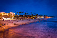 The beach at night, seen from the pier in Oceanside  Stock Photos