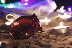 Beach at night. Sunglasses towel Royalty Free Stock Images