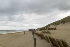 Beach at the North of the Netherlands and the North Sea. Beach in the North of the Netherlands with a fence, the dunes and a beach pavilion Stock Photos