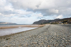 Beach in North Wales with many rocks and pebbles on it Royalty Free Stock Images