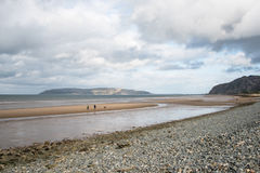 Beach in North Wales with many rocks and pebbles on it Royalty Free Stock Photo