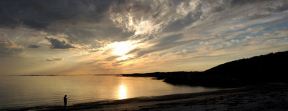 Beach of Norway. The sun struggles with the invasive clouds at a beach of northern Norway Royalty Free Stock Photo
