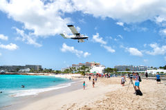 Beach observe low flying airplanes landing near Maho Beach. International jet flight lands over Maho beach at Princess Juliana airport on Caribbean island of St Royalty Free Stock Photography