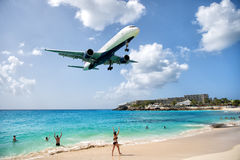 Beach observe low flying airplanes landing near Maho Beach. St Maarten, Netherlands - February 13, 2016: beach observe low flying airplanes landing near Maho Royalty Free Stock Images