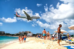 Beach observe low flying airplanes landing near Maho Beach. St Maarten, Netherlands - February 13, 2016: beach observe low flying airplanes landing near Maho Royalty Free Stock Photo