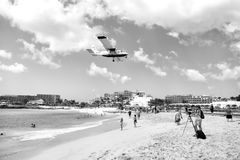 Beach observe low flying airplanes landing near Maho Beach. St Maarten, Netherlands - February 13, 2016: International jet flight lands over Maho beach at Stock Image