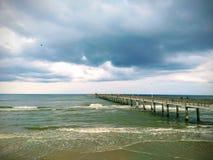 Beach ocean fishing Pier. Beach ocean fishing port pier royalty free stock photo
