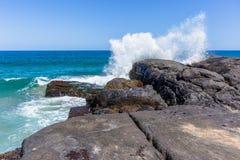 Beach Ocean Large Boulders Wave Spray royalty free stock image