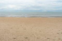 Beach ocean relax sand summer sunlight cloud beauty Royalty Free Stock Images
