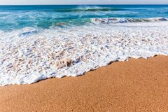 Beach Ocean Shoreline Wash. Beach shoreline waters edge blue ocean wave wash over sand closeup scenic nature horizon landscape stock photography