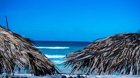 Beach. Ocean with 2 beach umbrellas royalty free stock image