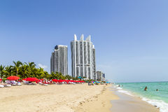 Beach with oceanfront resorts in Sunny Isles Beach. SUNNY ISLES BEACH, USA - AUG 17, 2014: Beach with oceanfront resorts in Sunny Isles Beach, Florida Royalty Free Stock Images