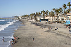 On the beach in Oceanside. Oceanside, United States - December 25, 2015: Visitors and tourists enjoying themselves in fine weather at the beach of Oceanside on Royalty Free Stock Images