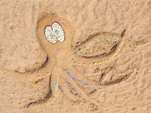 Beach Octopus on Sand Background - Stock Photo Stock Photos