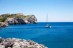 Beach off the coast of the island of Rhodes in Faliraki, Greece. Royalty Free Stock Image
